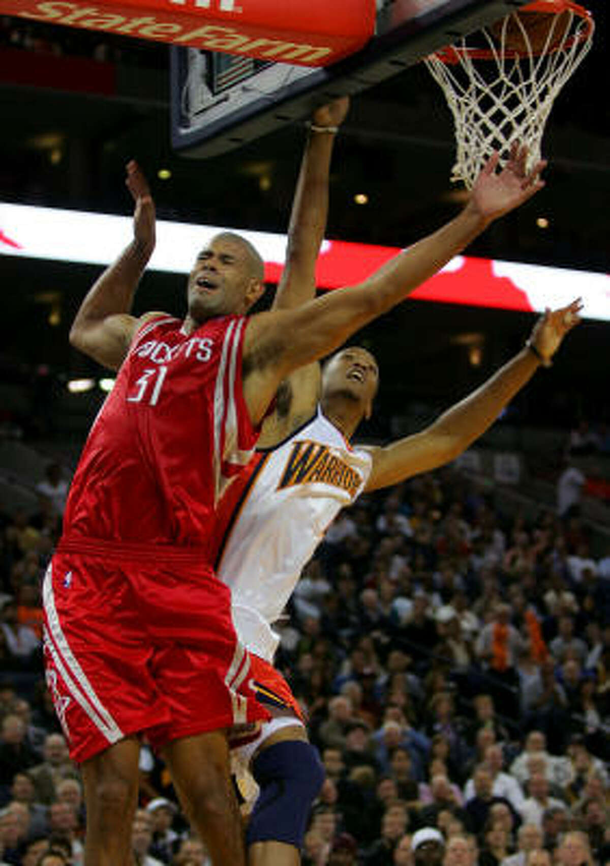 Shane Battier, left, is fouled by Anthony Randolph as Battier goes up for a lay-up. Battier knocked down all six of his free throws on the night and scored nine points.