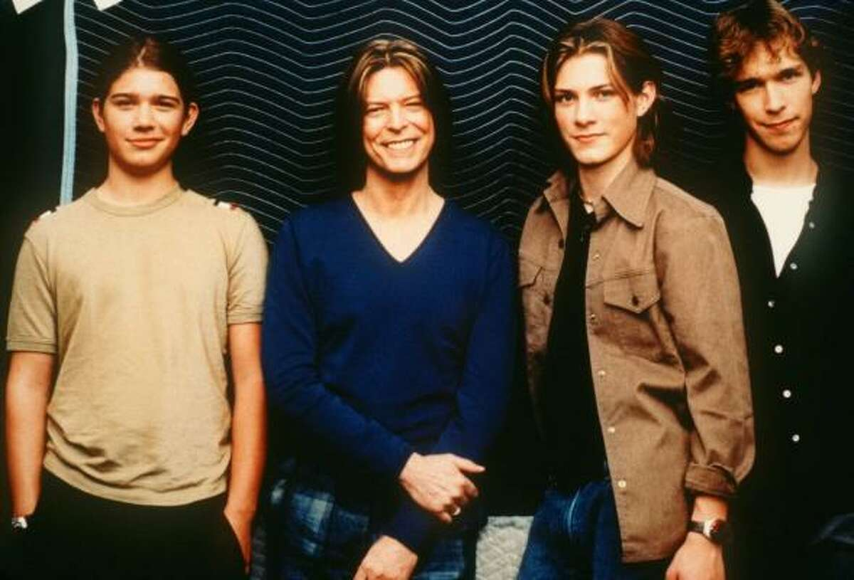 Singers Zac Hanson, David Bowie, Taylor Hanson and Isaac Hanson, from left, in 2000.