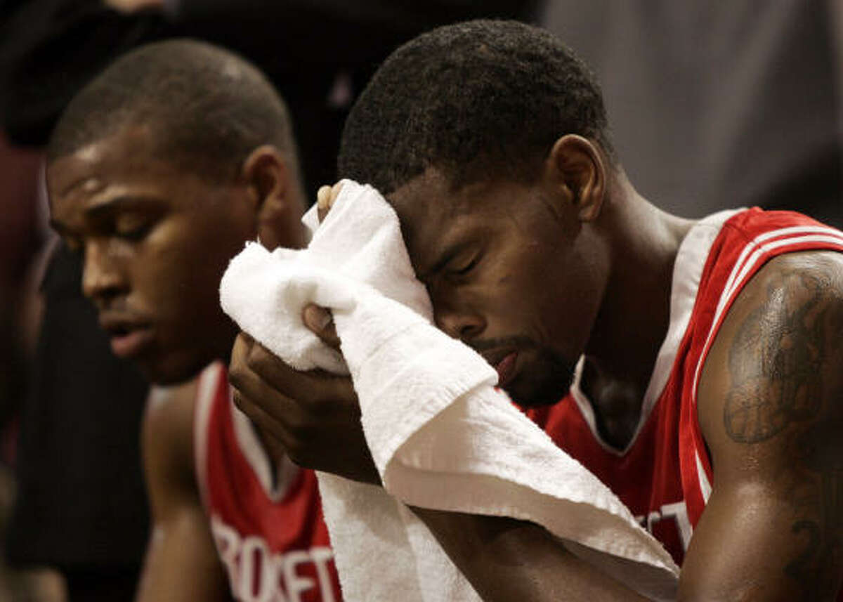 Blazers 96, Rockets 87 Rockets guards Aaron Brooks, right, and Kyle Lowry sit on the bench during the loss.