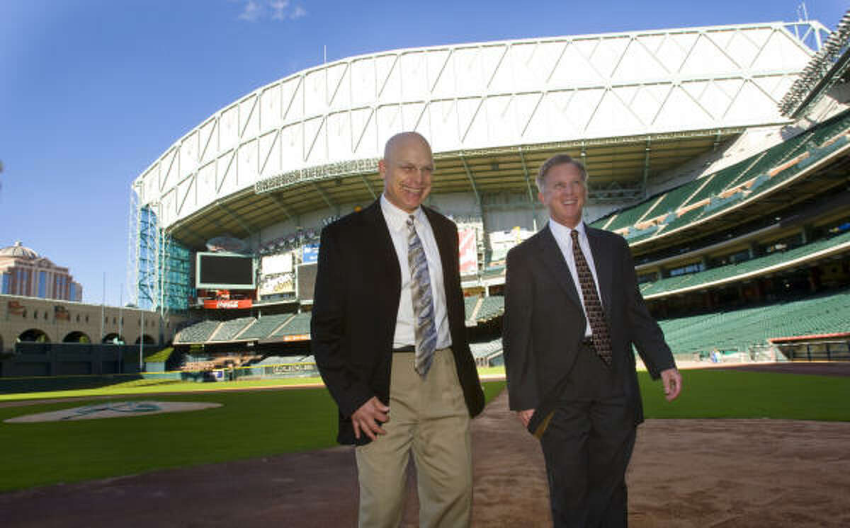 Brad Mills smiles as he stands on the field with general Manager Ed Wade at Minute Maid Park after he was named as the new manager.