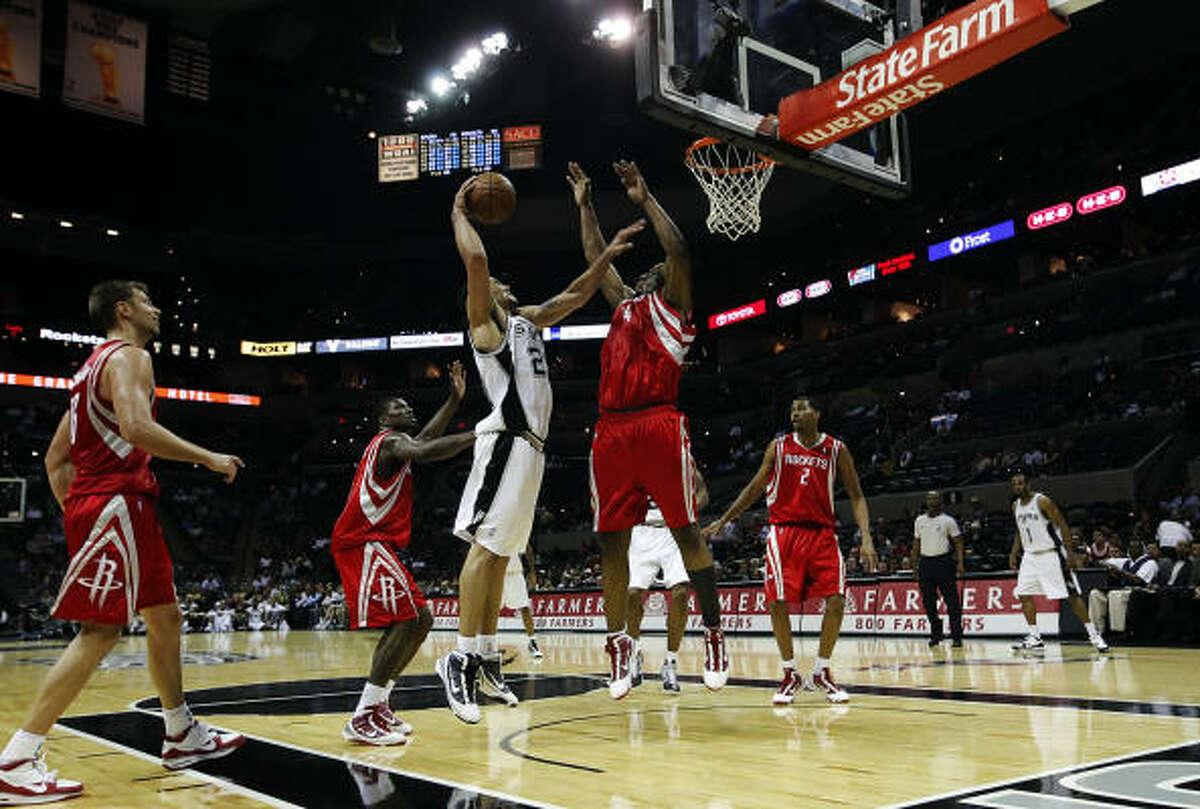 Oct. 6: Rockets 99, Spurs 85 The Spurs' Dwayne Jones goes up for a basket against Rockets forward Carl Landry.