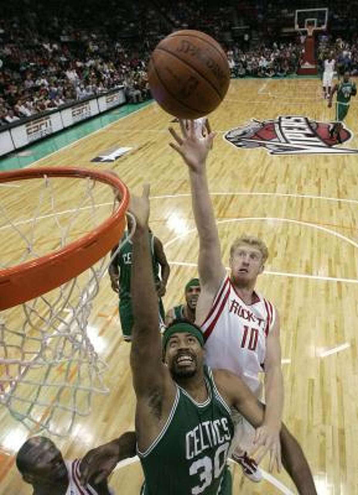 Oct. 7: Rockets 96, Celtics 90 The Celtics' Rasheed Wallace and the Rockets' Chase Budinger jump for a rebound in the first half.