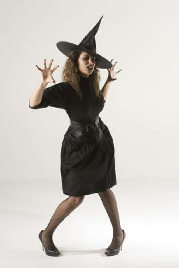 With a little make-up and a hat, the classic witch costume can be easily thrown together as a last minute, cheap Halloween costume. Photo: Brett Coomer, Houston Chronicle