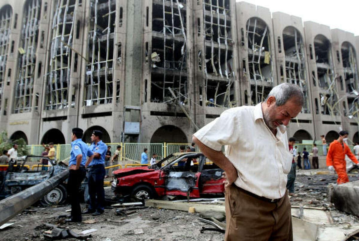 An Iraqi weeps as he walks away from the destruction.