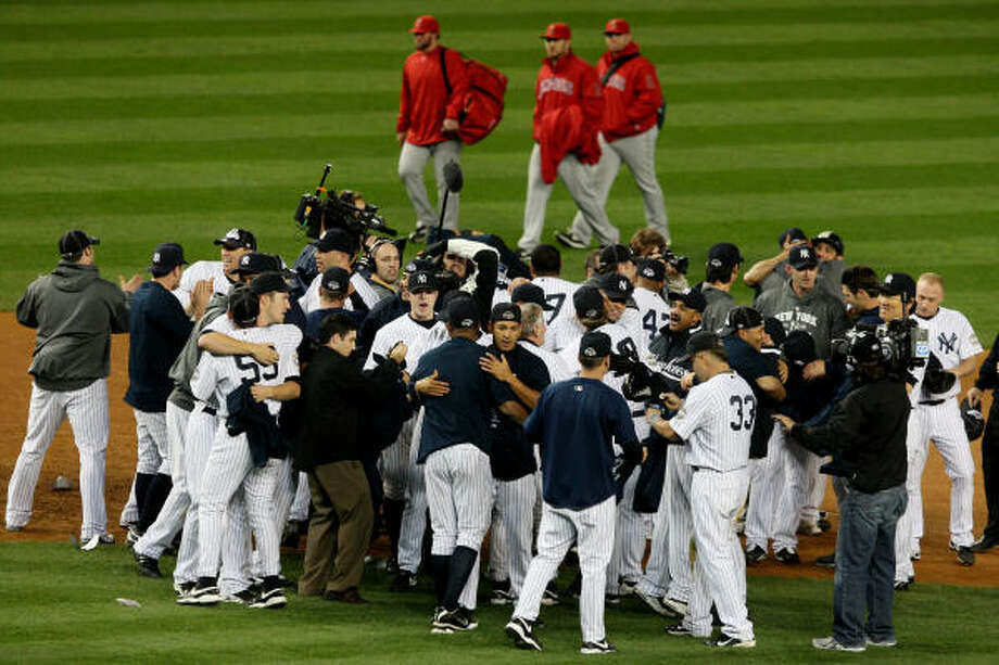 Game 6: Yankees 5, Angels 2The New York Yankees celebrate their win over the Los Angeles Angels in Game 6 of the ALCS on Sunday night at Yankee Stadium in New York. The Yankees won the ALCS, 4-2, and will advance to the World Series to face the Philadelphia Phillies. Photo: Jim McIsaac, Getty Images