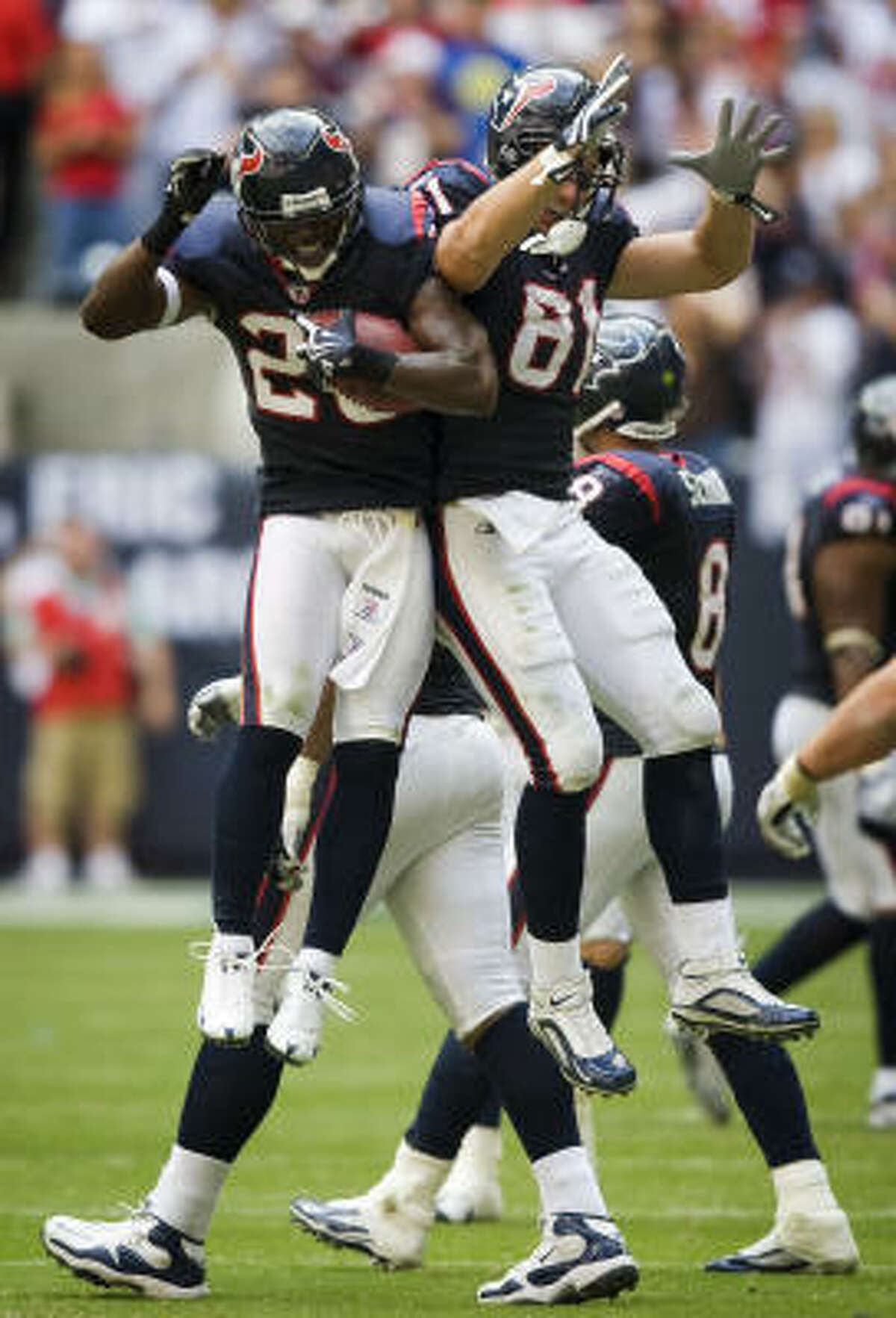 Texans safety Eugene Wilson (26) celebrates with tight end Owen Daniels (81) after Wilson intercepted a pass to seal the win.