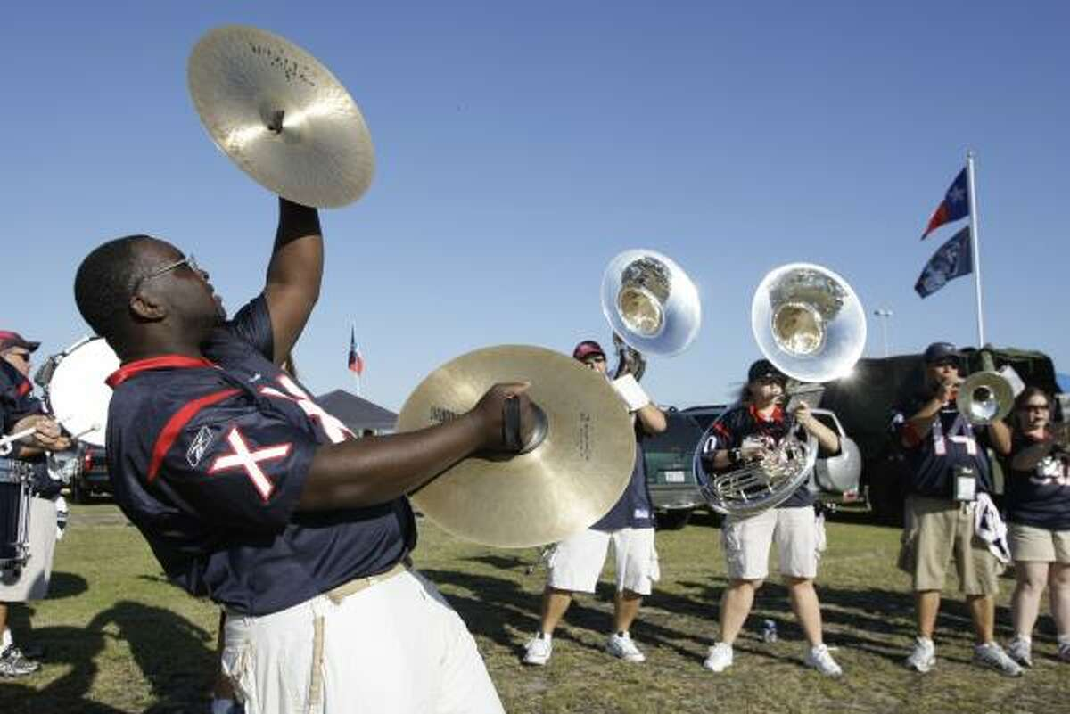 Members of the Texans' Bull Pen pep band play for fans outside Reliant Stadium.
