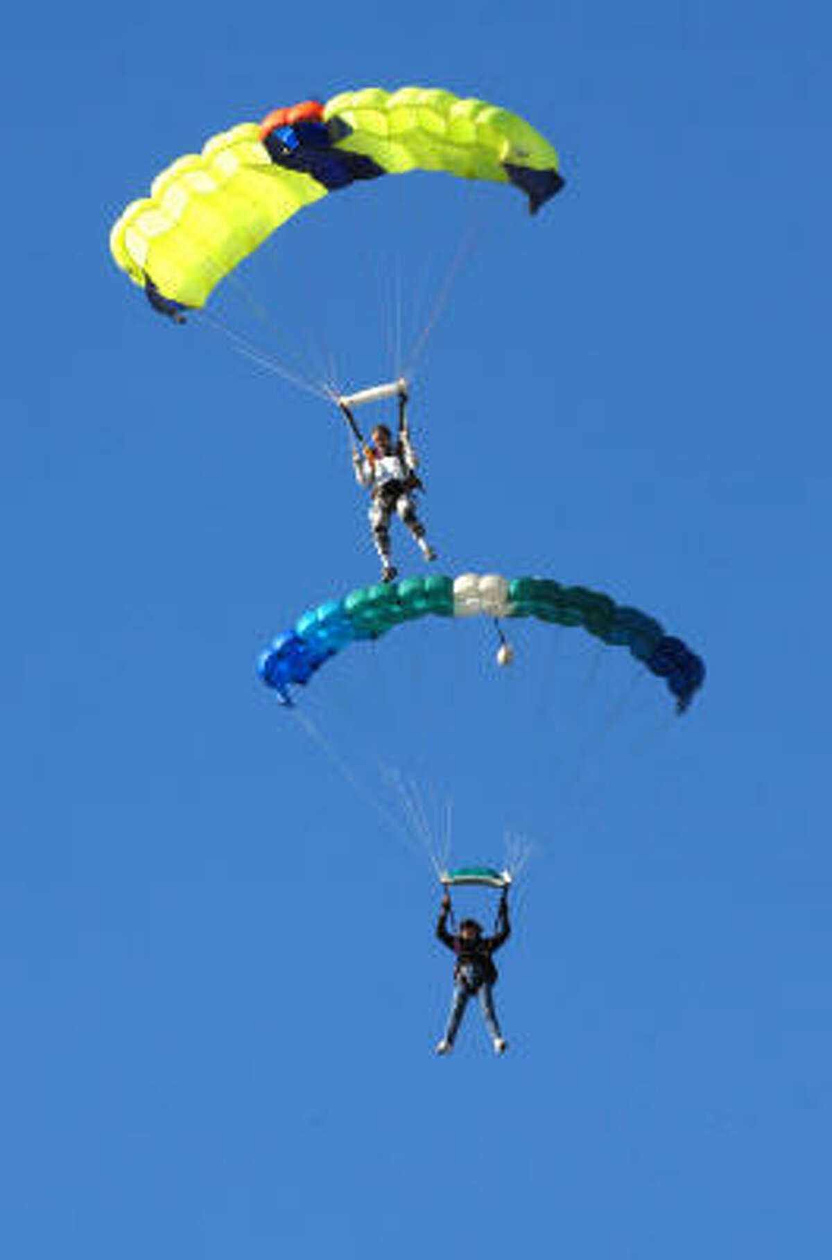 When balloons aren't flying, skydivers give demonstrations.