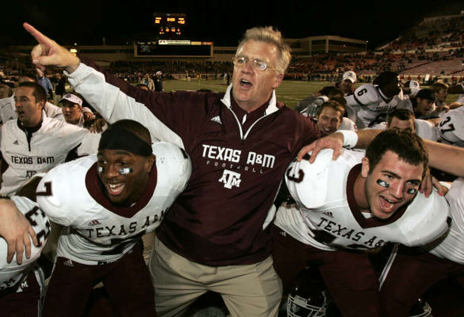 Texas A&M coach Mike Sherman celebrates with players Uzoma Nwachukwu, left, and Aaron Arterburn after Saturday's victory against Texas Tech in Lubbock. Photo: Mike Fuentes, Associated Press