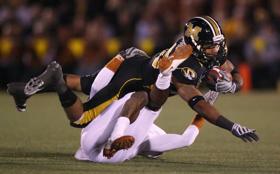 Missouri running back De'Vion Moore is tackled by Texas cornerback Deon Beasley in second quarter action. Photo: Chris Lee, MCT