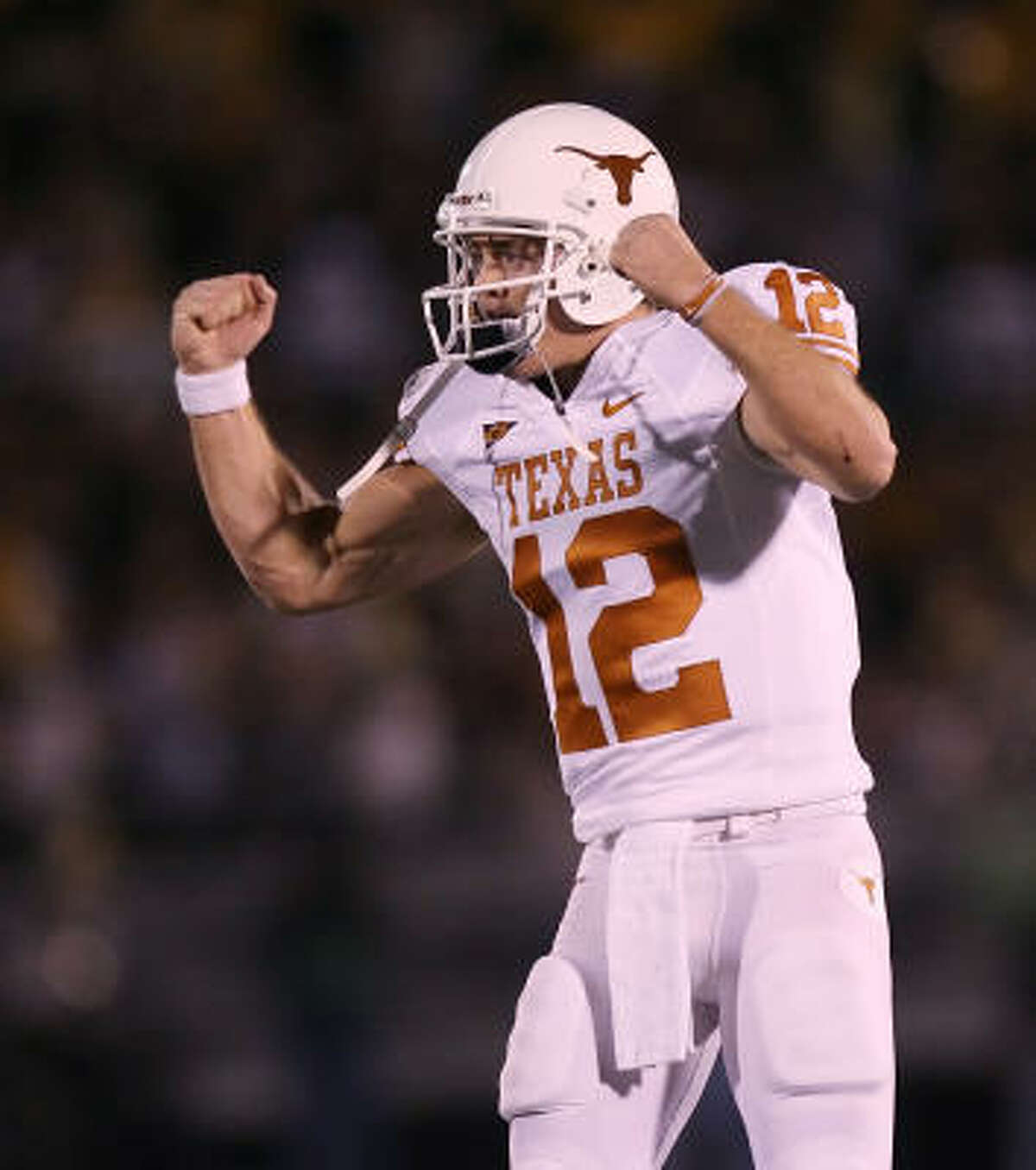 Texas quarterback Colt McCoy celebrates after throwing a touchdown pass to wide receiver Jordan Shipley in the second quarter.