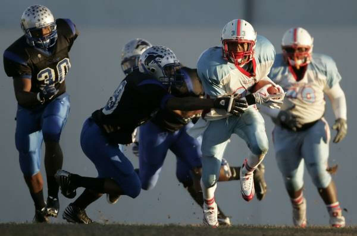 Madison's Kerrell McDougle (right) scampers past Chavez's James Johnson during the first quarter.