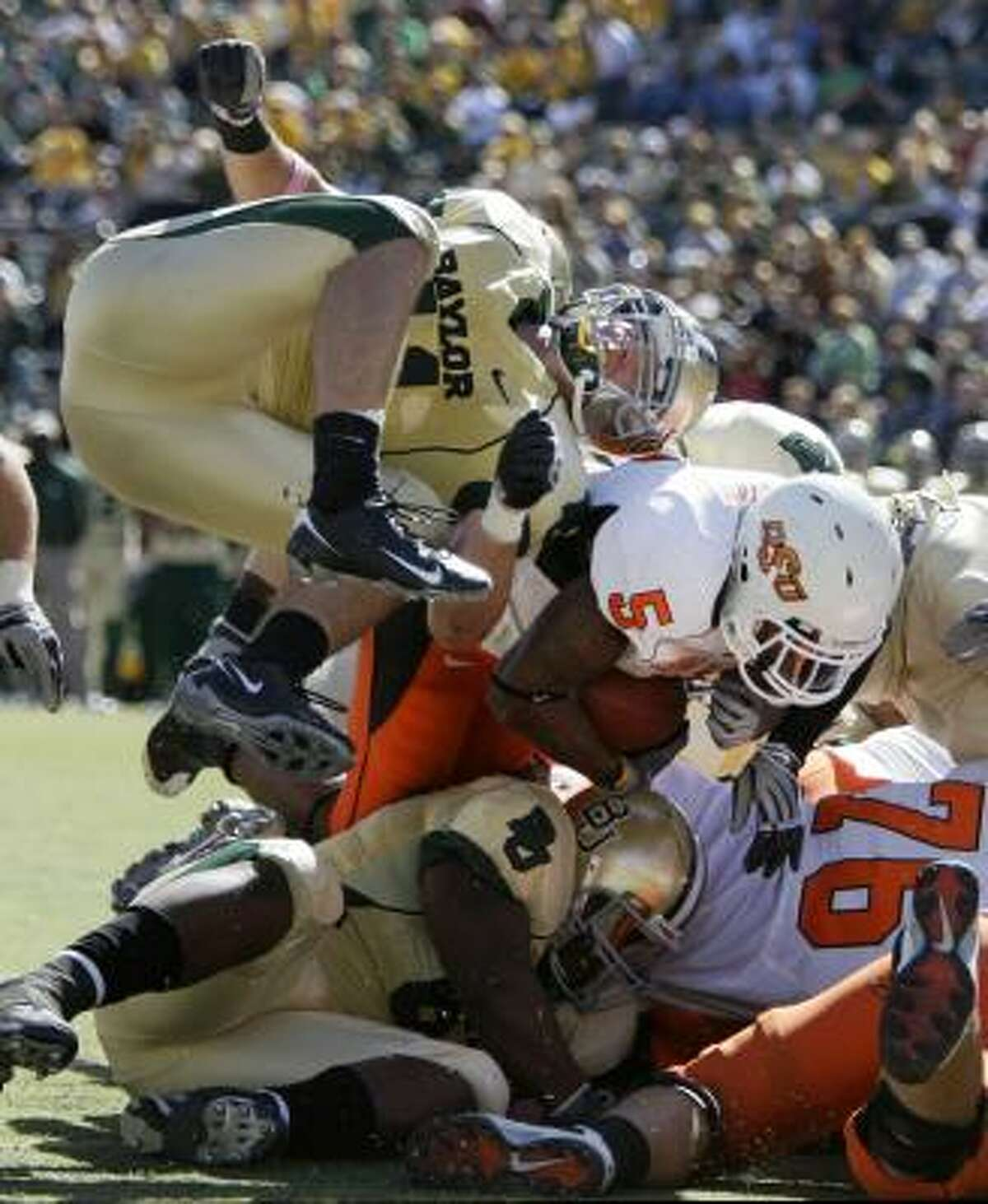 Baylor linebacker Joe Pawelek attempts to stop Oklahoma State running back Keith Toston as he pushes through for a touchdown during the second half Saturday in Waco.