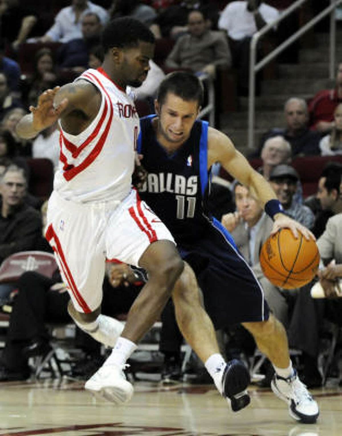 Rockets guard Aaron Brooks, left, defends Dallas' Jose Barea in the first half of Friday's preseason game at Toyota Center.