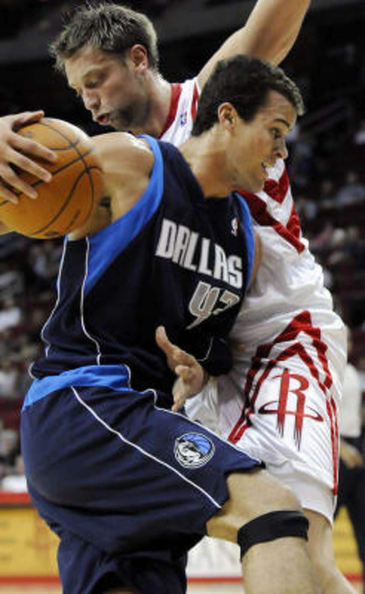 Dallas' Kris Humphries, left, drives the ball against Houston's David Andersen.