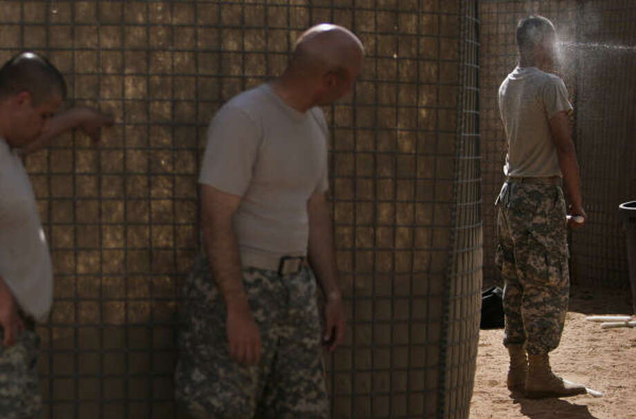 Staff Sgt. James Singleton, of Conroe, is sprayed with Oleresin Capsicum (OC) Spray (or pepper spray) before going through a self-defense obstacle course. The soldiers are members of Delta Company, 3rd Battalion, 141st Infantry Regiment, 72nd Infantry Brigade Combat Team, a Houston-based Texas National Guard unit headed to Iraq at the end of this year. Photo: Mayra Beltran, Chronicle