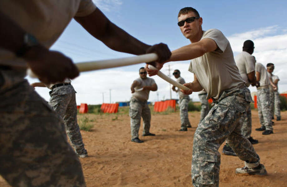 1st Lt. Sean Lindley, of Austin, right, practices the unarmed self-defense at Camp McGregor. Photo: Mayra Beltran, Chronicle