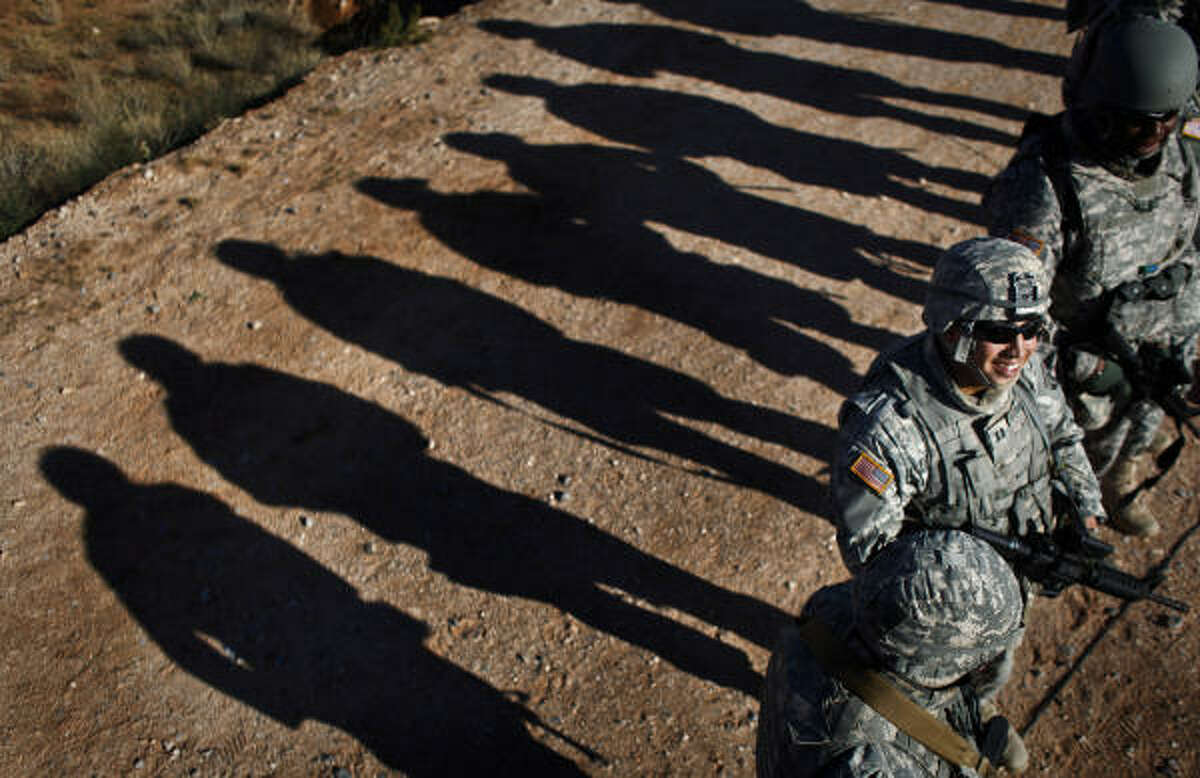 Members of the Texas National Guard's 72nd Infantry Brigade Combat Team wait to begin the Short Range Marksmanship Lane at Camp McGregor.
