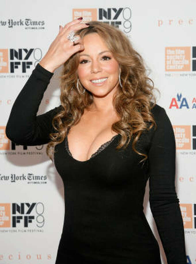 Many think Mariah's mane is not all hers. What do you think? Leave a comment below. Photo: Amy Sussman, Getty Images