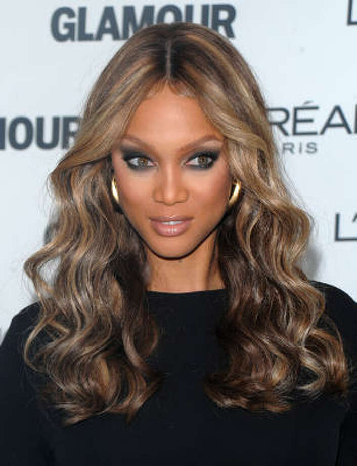 Tyra Banks has come out of the closet and not only admitted to wearing wigs, but appeared on her talk show with her real hair. Photo: Peter Kramer, AP