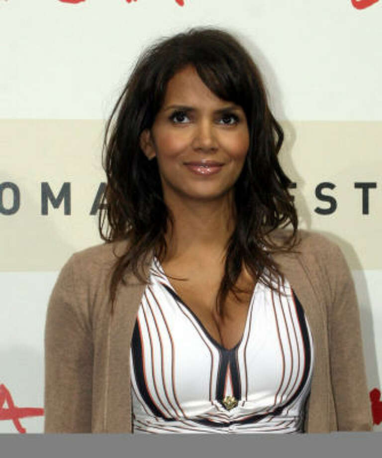 Halle Berry goes between long hair and a pixie cut quite a bit. Wonder if she gets any assistance? Photo: Sandro Pace, AP