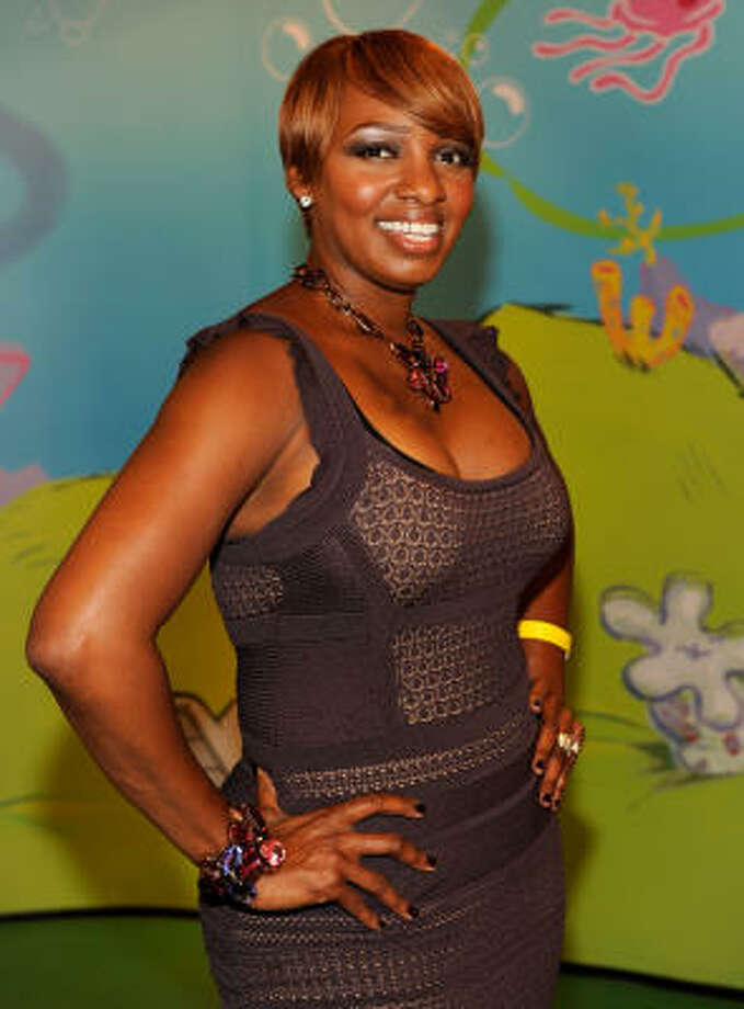 Even though NeNe Leakes of Bravo's The Real Housewives of Atlanta has short hair, she uses pieces to make her hair look fuller, according to her hair dresser. Photo: Larry Busacca, Getty Images For Nickelodeon