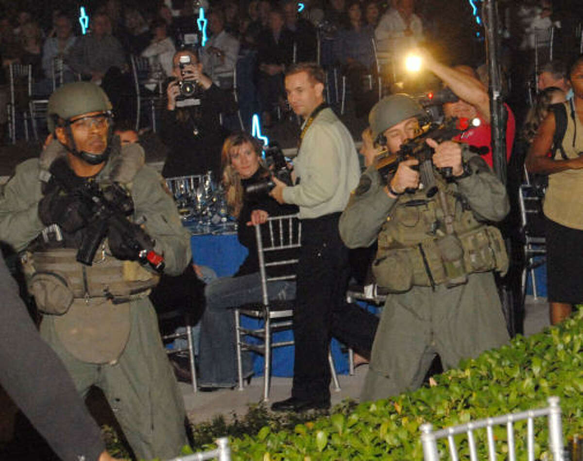 HPD's SWAT team members participate in a demonstration at the Second Annual True Blue Gala sponsored by the Houston Police Foundation at the home of Paige and Tilman Fertitta Saturday Oct. 17.