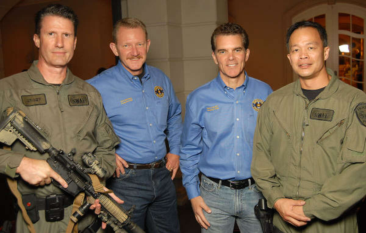 From left: SWAT team member George Griger, Don McKinney, Brian Lumpkin and SWAT team member Ed Lem