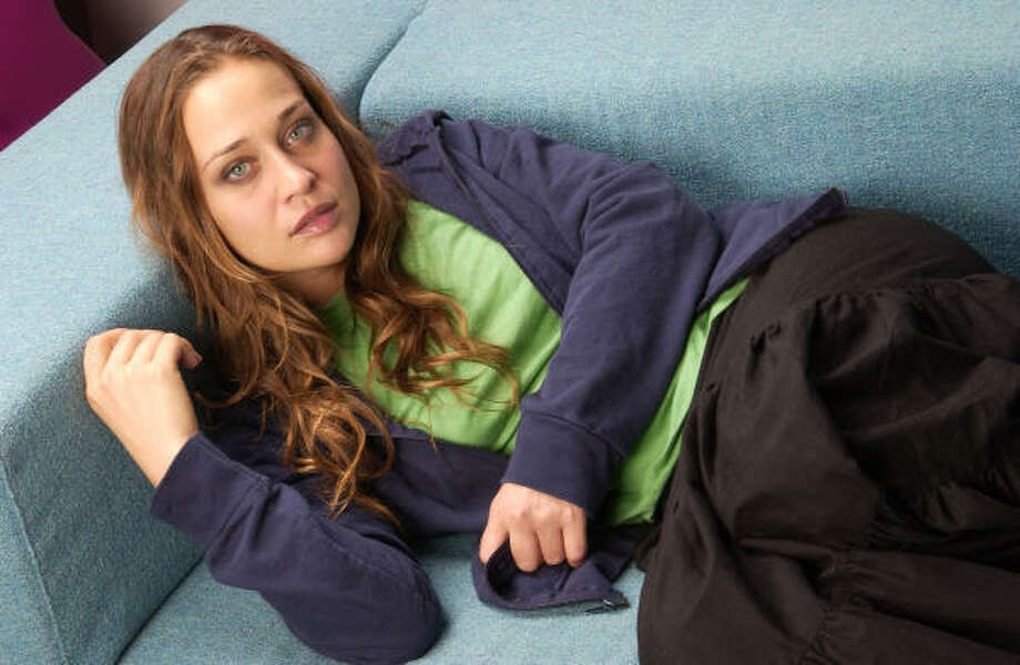 """Millions of people are learning that a vegetarian diet is the healthy choice for themselves, the Earth and the animals,"" said singer Fiona Apple in a PETA campaign. Read more about vegan fashion here. Photo: JIM COOPER, AP"