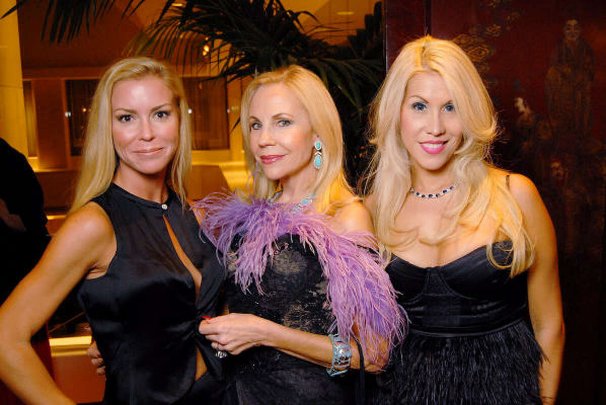 From left: Heather Baker, Carolyn Farb and Leslie Tyler-Fink at the Dominic Walsh Dance Theater's Firebird Soiree at the Four Seasons Hotel Saturday Oct. 17.