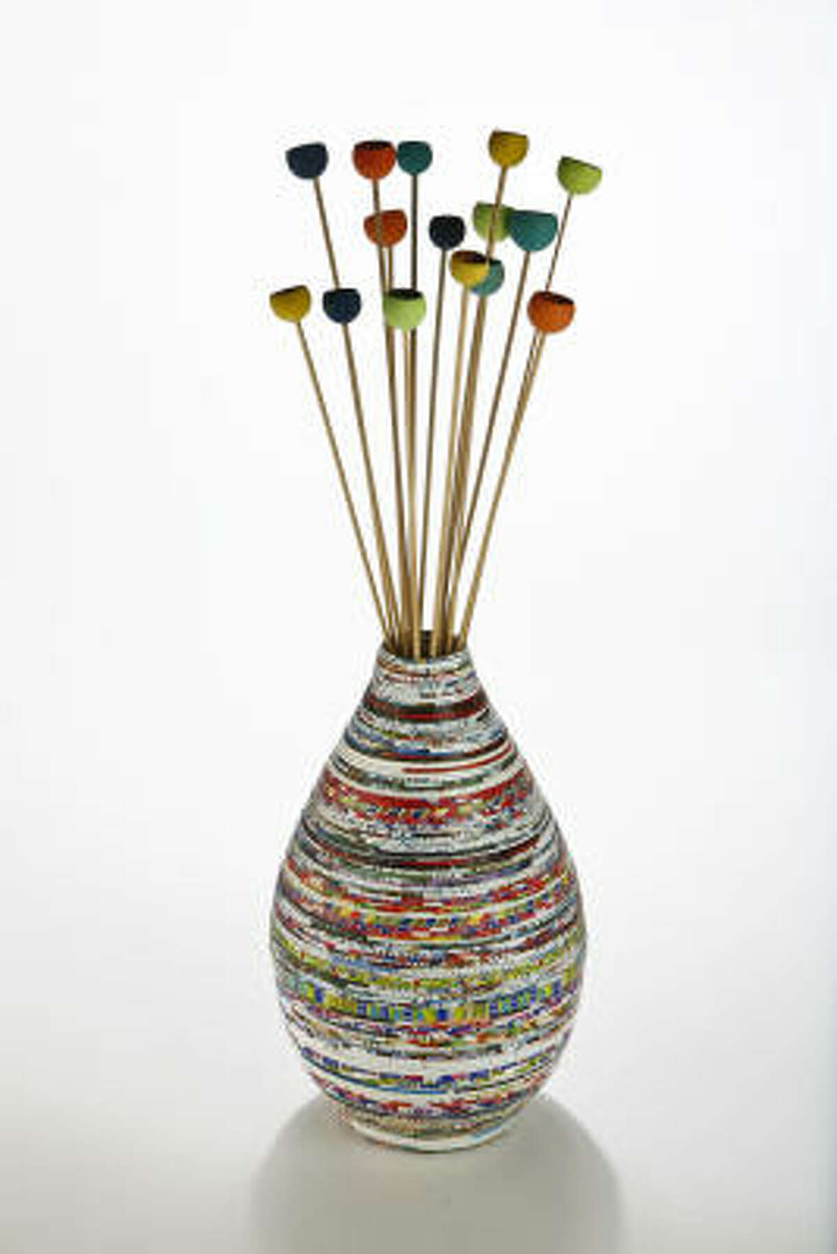 Shopping for recycled and vegan items is not always an easy task. Take a look at some things that are budget and eco friendly. Recycled paper vase, $30, and Wooden pods on sticks, $14 for a bunch, Ten Thousand Villages, 2424 Rice Blvd.