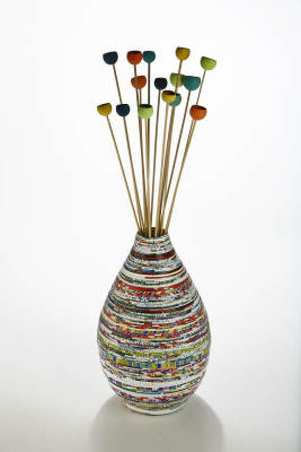 Shopping for recycled and vegan items is not always an easy task. Take a look at some things that are budget and eco friendly.  Recycled paper vase, $30, and Wooden pods on sticks, $14 for a bunch, Ten Thousand Villages, 2424 Rice Blvd. Photo: Michael Paulsen, Houston Chronicle
