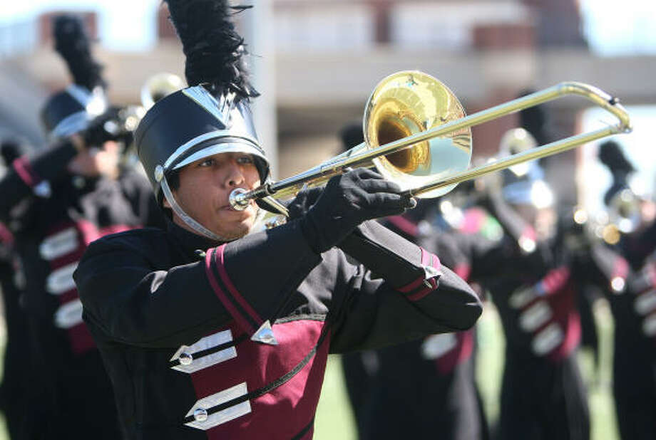 Michael Basaldua, a senior at Cy-Fair High, performs during the UIL marching band contest. Photo: Thomas Nguyen, For The Chronicle