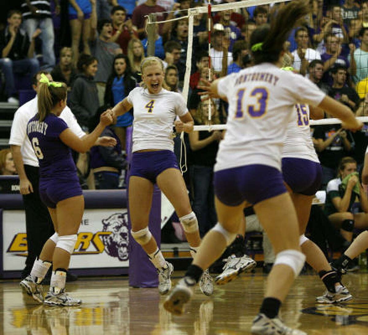 Montgomery's Kristen Bean (4) leads the celebration as she and her team tie the match at two games apiece.