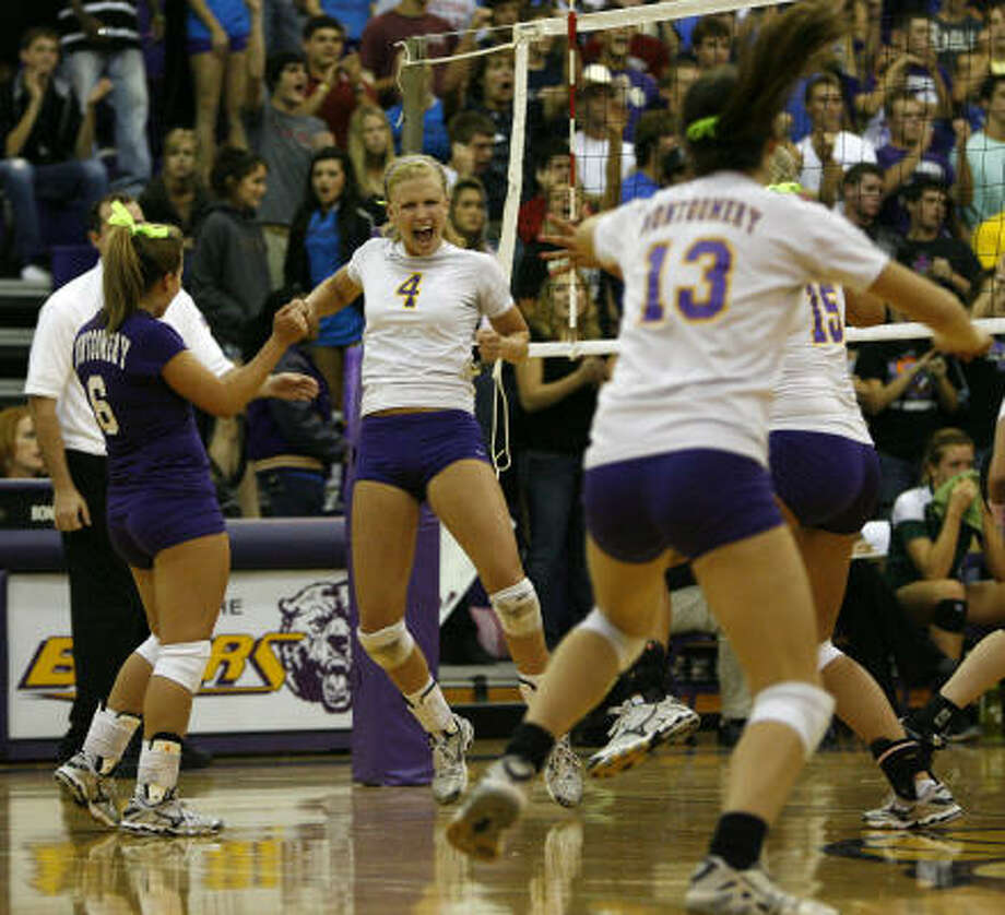 Montgomery's Kristen Bean (4) leads the celebration as she and her team tie the match at two games apiece. Photo: Karen Warren, Chronicle