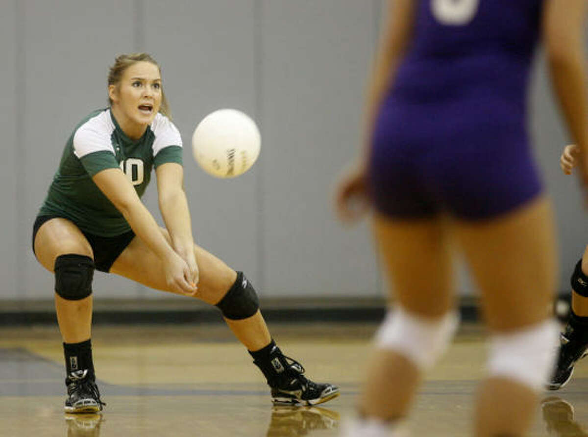 Brenham's Bethany Yeager digs the ball during her team's road victory.