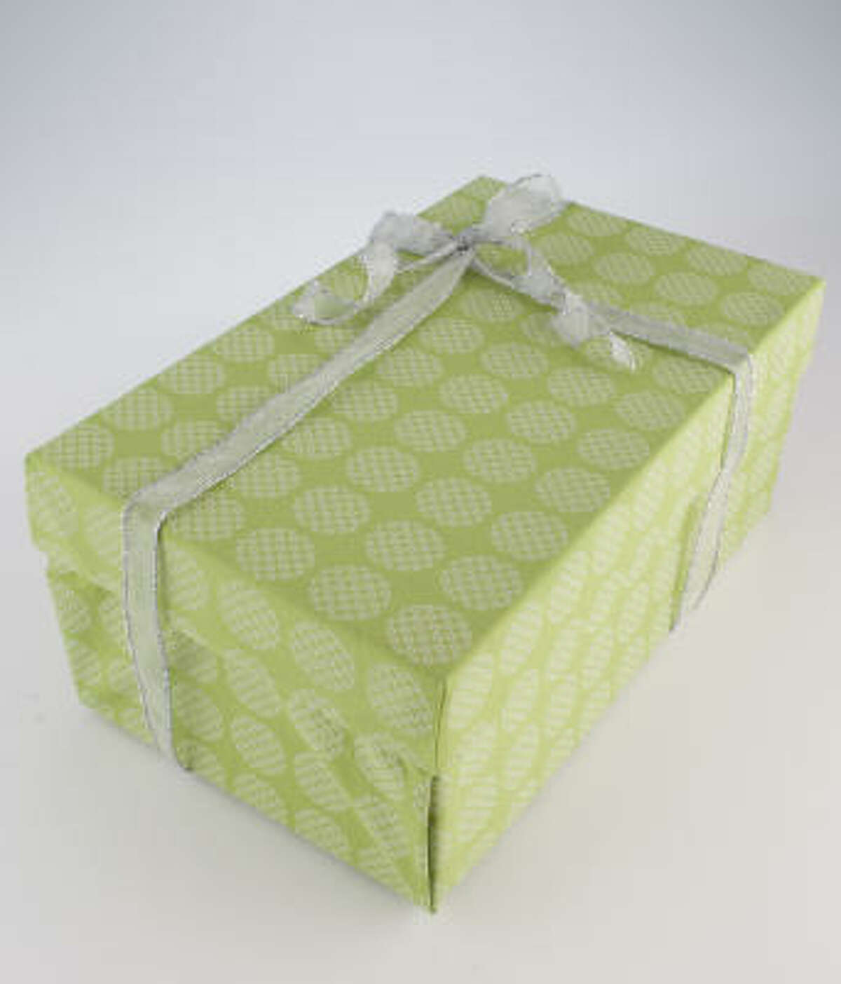 You can also create your own storage box by covering it with cotton fabric.