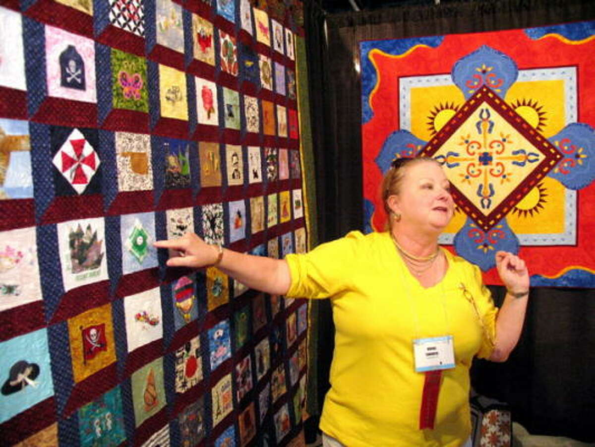 Moira Cannata discusses her quilt at the International Quilt Festival on Saturday, Oct. 17.