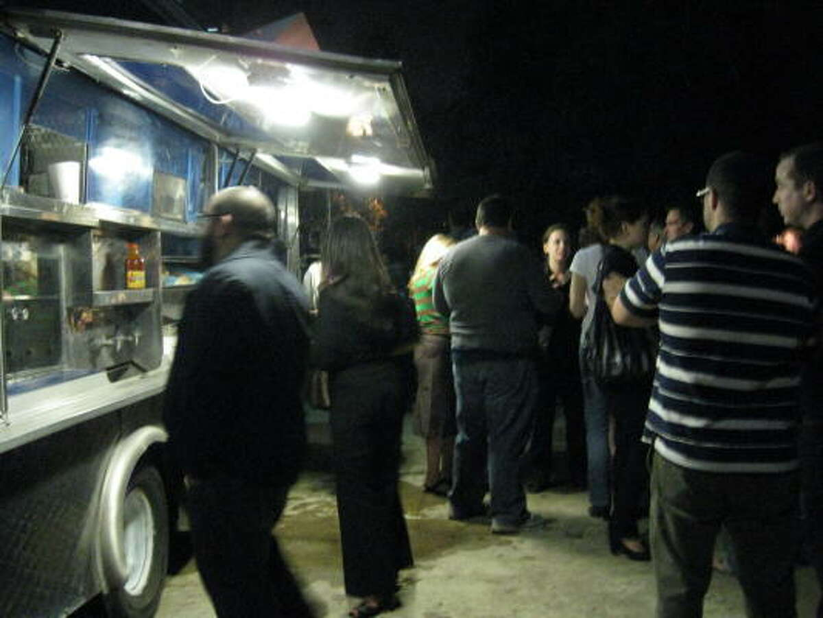 A taco truck outside the Contemporary Arts Museum Houston kept the crowd for the opening of Matthew Day Jackson's The Immeasurable Distance happy.