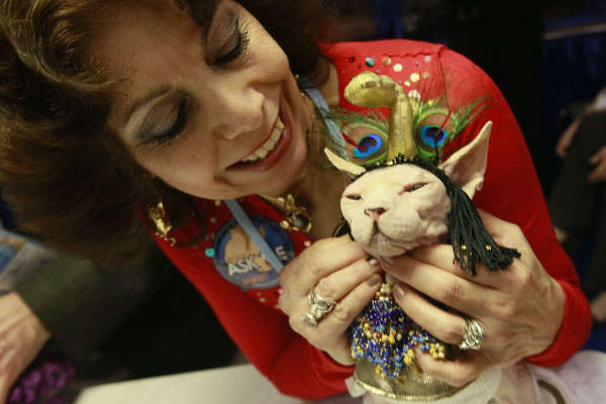 Sandy Adler of Westchester, N.Y., pets her 13-year-old Sphynx Hale Bop.
