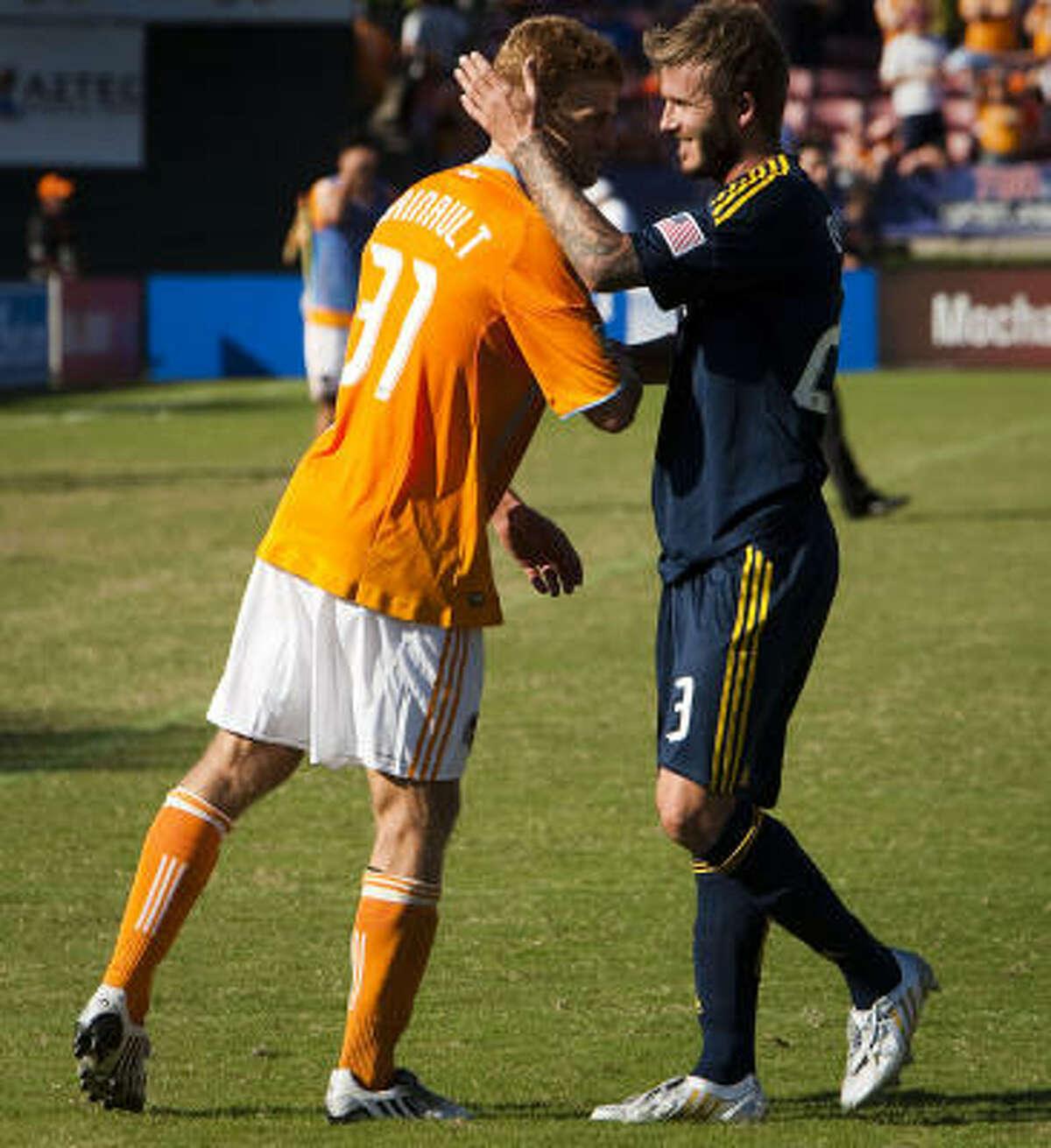 David Beckham of the Los Angeles Galaxy hugs Dynamo defenseman Andrew Hainault following a scoreless draw against the Houston Dynamo at Robertson Stadium.