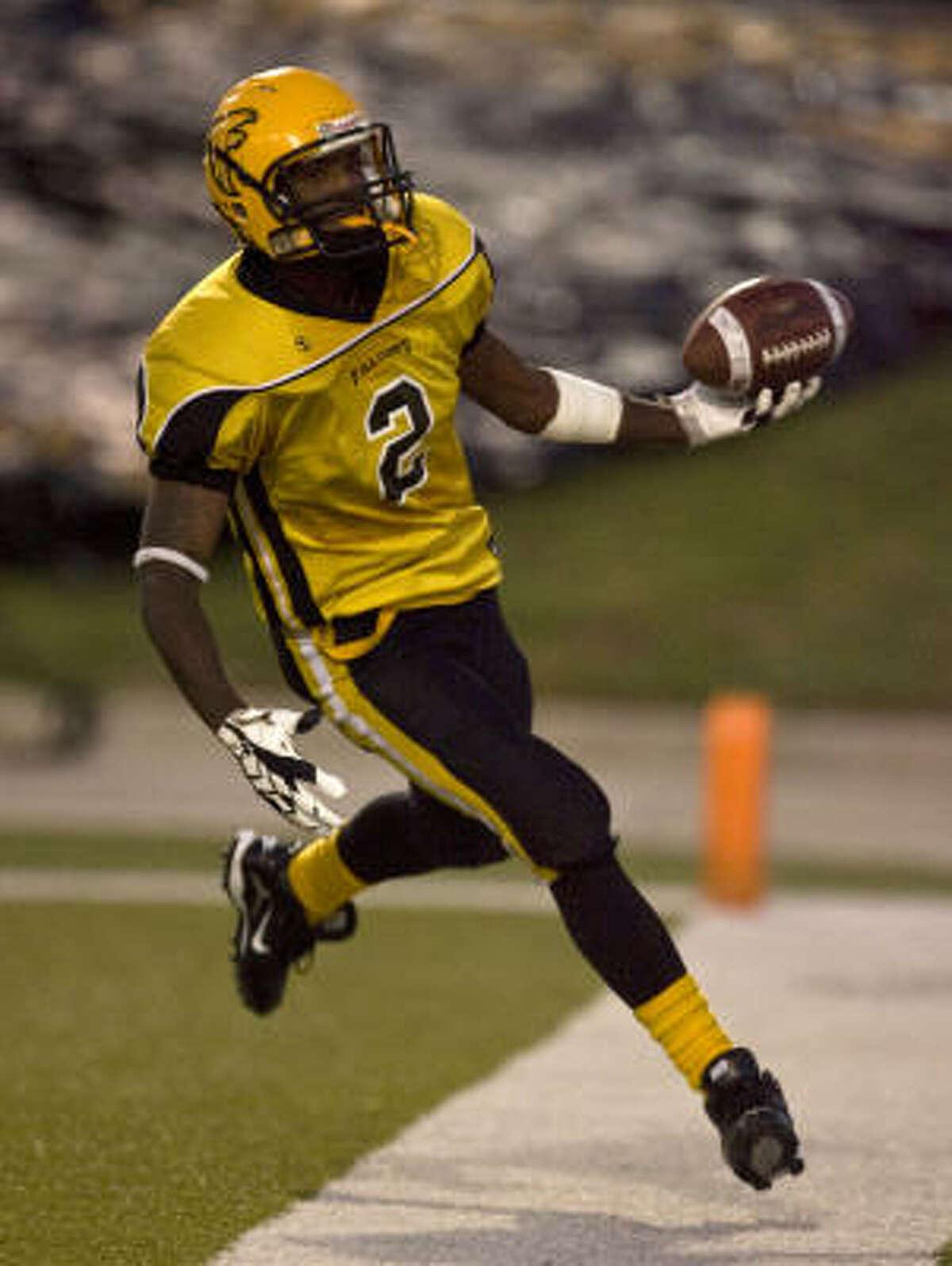 Jones 41, Wheatley 22 Jones' Michael Holmes celebrates after scoring a first-half touchdown against Wheatley during Saturday's District 22-4A battle at Delmar Stadium.