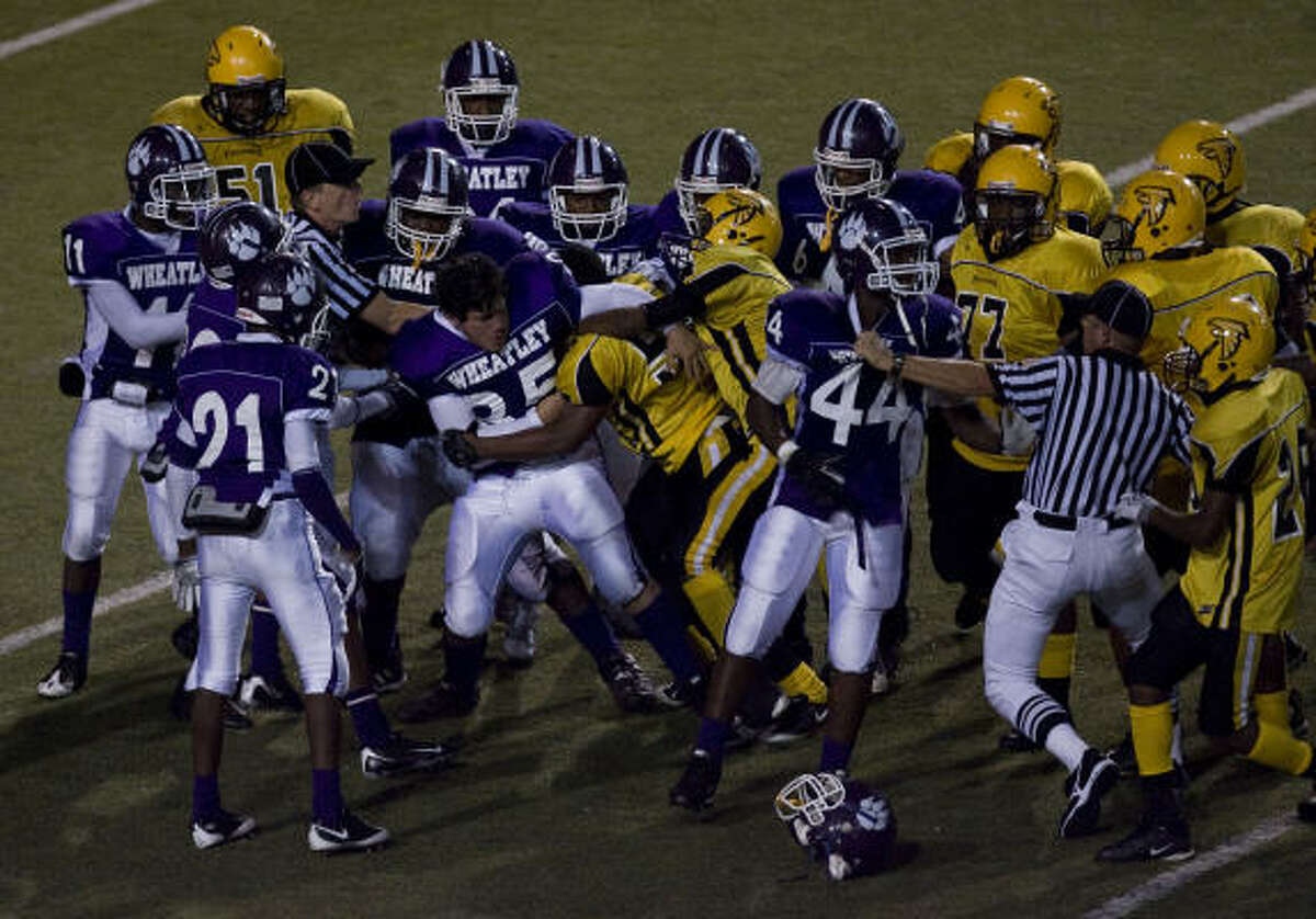Players mix it up after Jones defeated Wheatley on Saturday at Delmar Stadium.