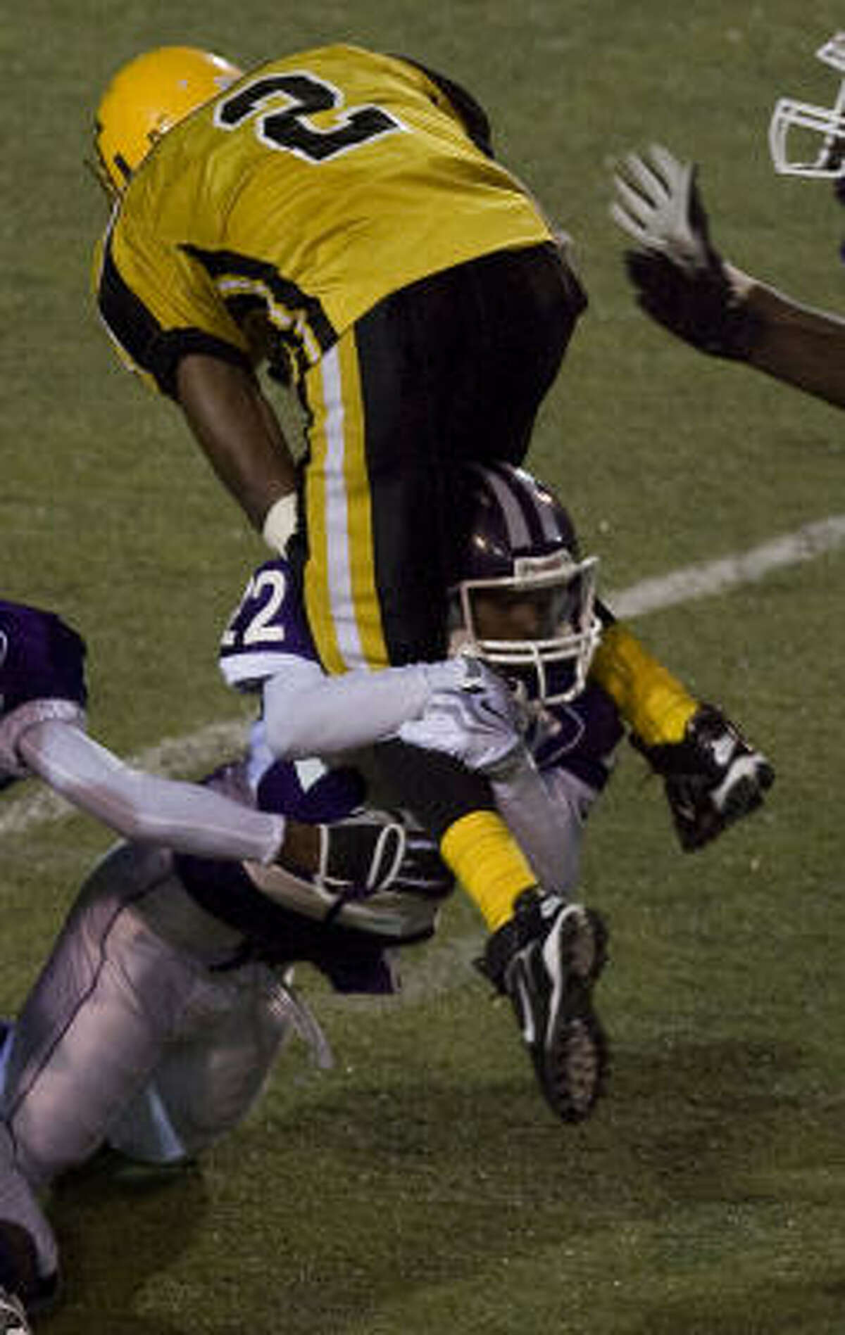 Jones' Michael Holmes, top, is tackled by Wheatley's Nehemiah Adams during the second half.