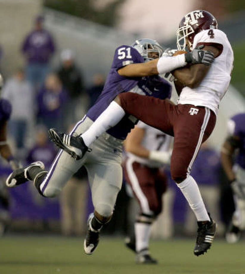 Texas A&M tight end Jamie McCoy catches a pass under pressure from Kansas State linebacker Ulla Pomele during the Wildcats' rout of the Aggies on Saturday night in Manhattan, Kan. Photo: Charlie Riedel, Associated Press