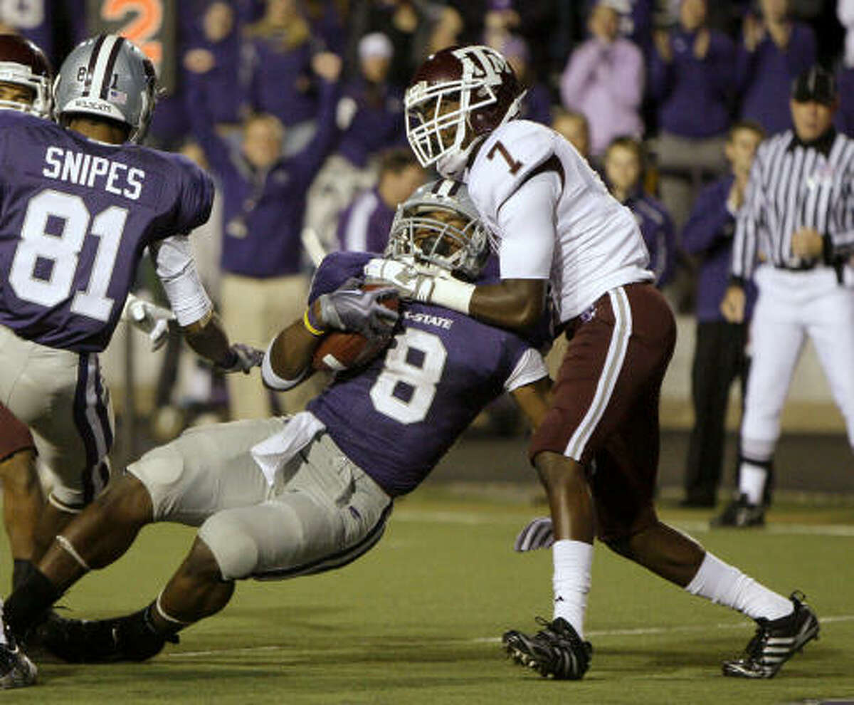 Kansas State running back Daniel Thomas falls into the end zone to score a touchdown as he is tackled by Texas A&M defensive back Terrance Fredrick during the second quarter.
