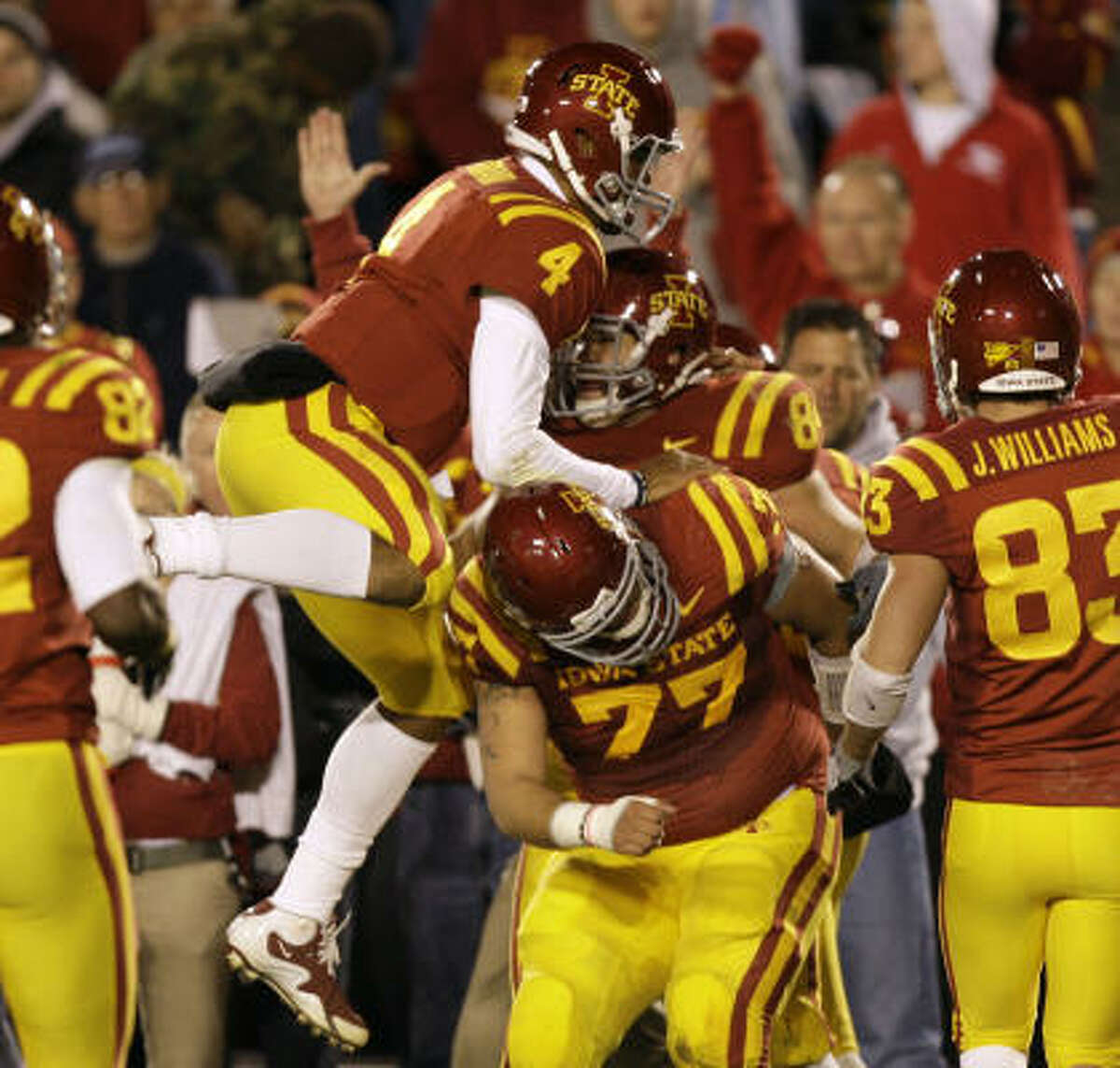 Iowa State quarterback Austen Arnaud (4) celebrates with teammates Derrick Catlett, center, Alex Alvarez (77) and Jake Williams, right, after Cetlett's touchdown reception.