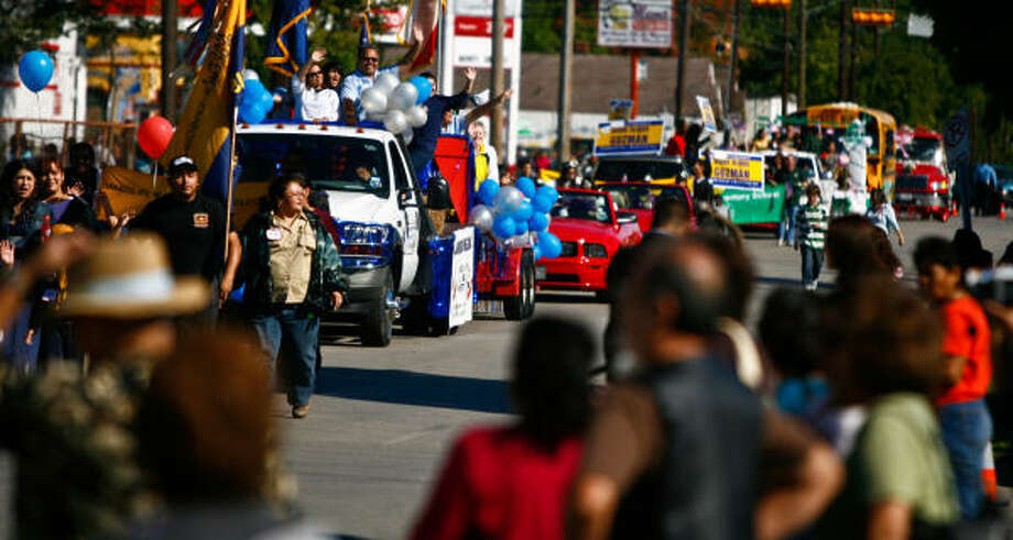 About 80 floats, flatbed trucks and school busses participated in the Magnolia Park Centennial Celebration parade in east Houston. Photo: Nick De La Torre, Chronicle
