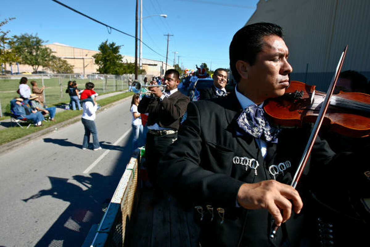 Juan Perez of Groupo Mariachi Loco plays on a flat bed truck during the Magnolia Park Centennial Celebration parade.