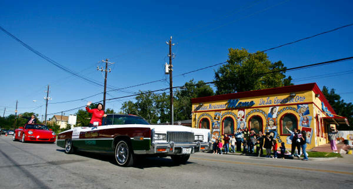 Carol Alvarado participates in the Magnolia Park Centennial Celebration parade by riding in the Taxis Fiesta lowrider.